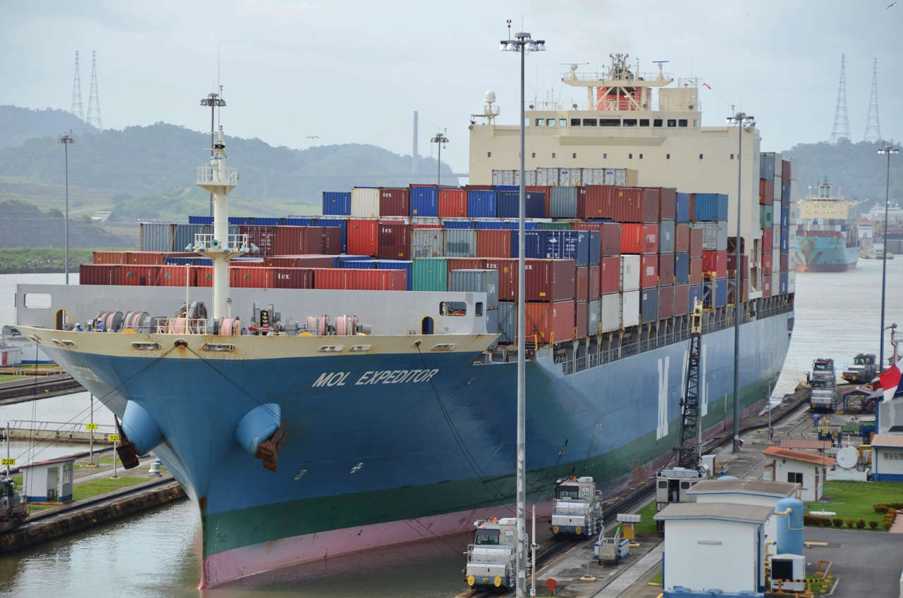 With only inches to spare on both sides, a big freighter passes through the Miraflores locks on the Pacific side of the Canal