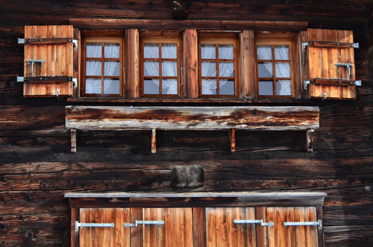 Beautiful windows of an old, wooden hut in Findeln