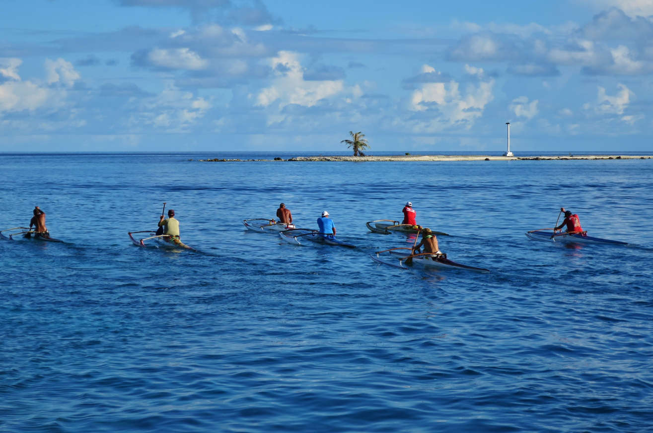 Local guys training in the evening for their next outrigger canoe competition