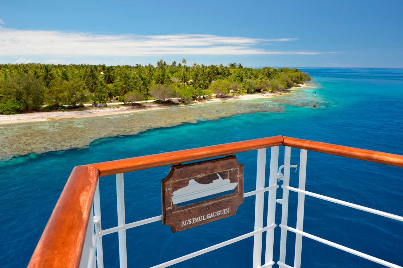 One of two major passes on Rangiroa, Tiputa welcomes visitors arriving by ship with an unbelievable array of blues