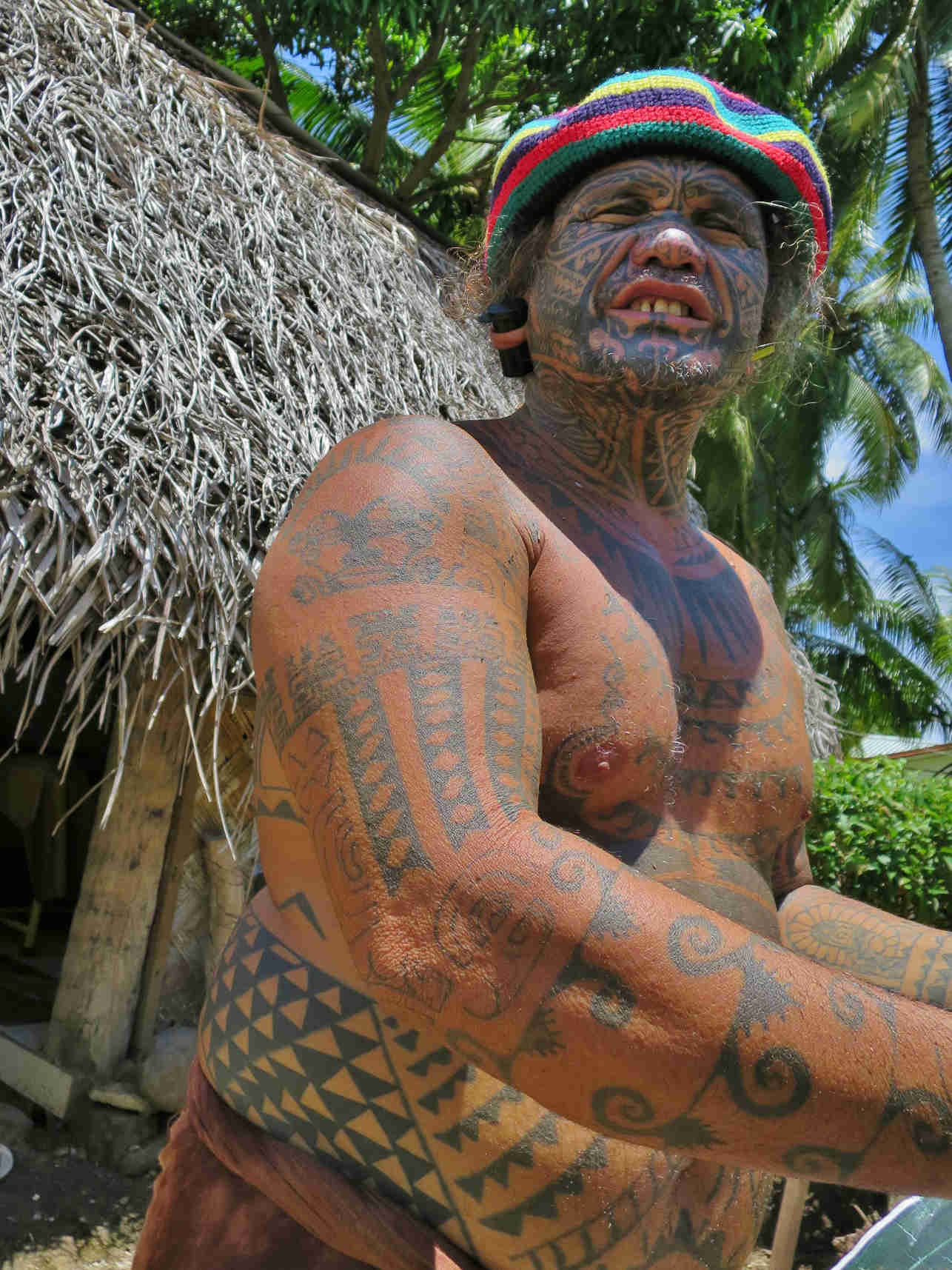 The tattoo artist Tavita makes body art the traditional way with carved boar bones and nut ink
