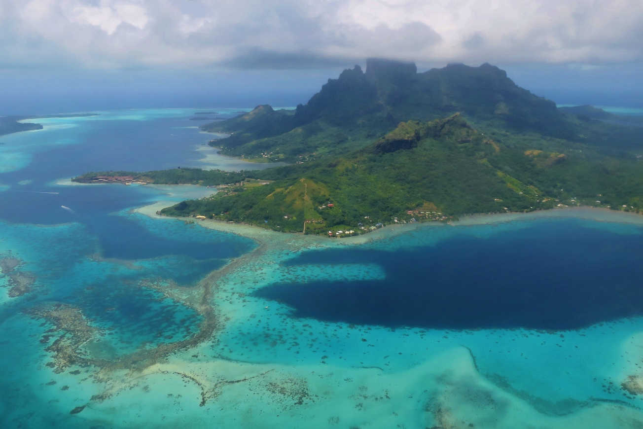 Aerial view of Bora Bora shows how shallow some parts of the lagoon are