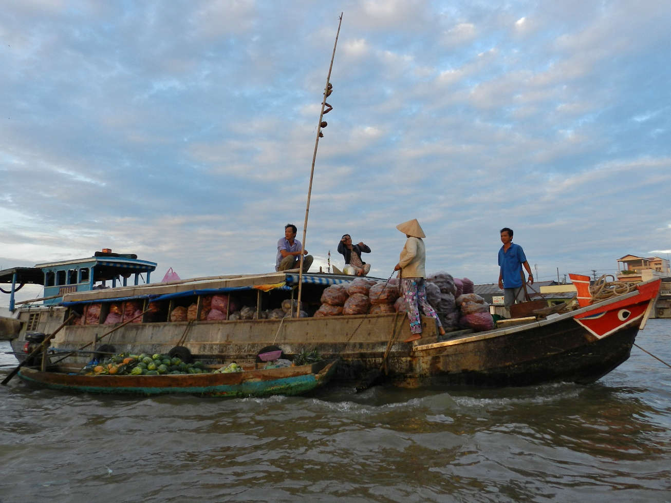 Cai Rang Market is, like most floating markets, at its busiest at dawn