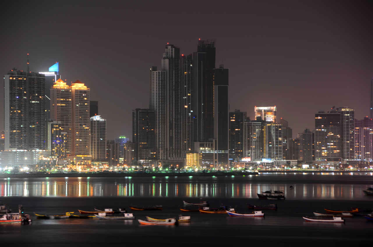 The Panama City skyline at night reflecting off the bay