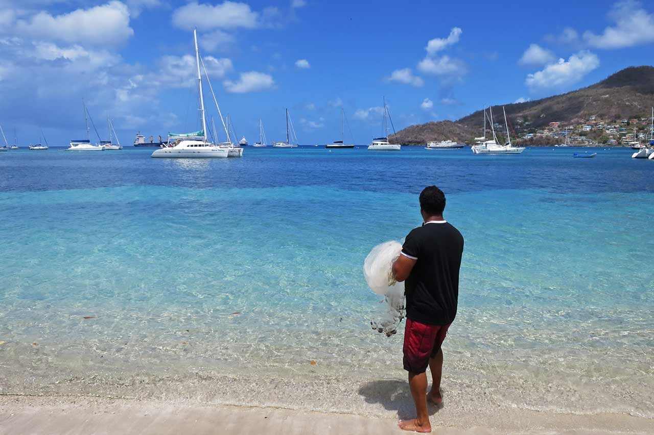 A local fisherman in Bequia about to catch sardines in the shallows