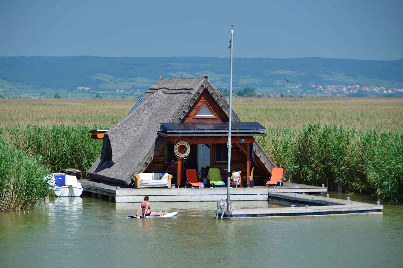 """Before vacationing abroad become """"in"""", locals used to spend their summer holidays in private stilt houses on Lake Neusiedl. Some still do so today."""