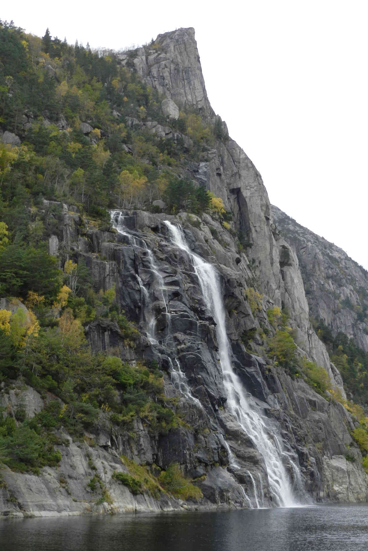 Many waterfalls rush down the steep walls of Lysefjord