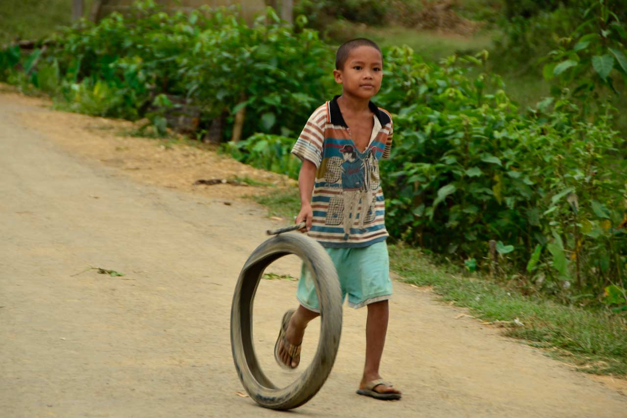 Kid in Mrauk U, Myanmar, hoop rolling