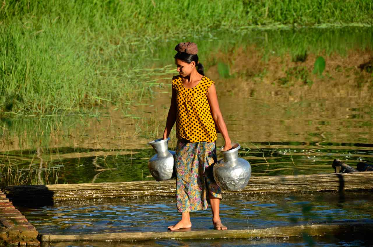 Woman getting water in Mrauk U, Myanmar